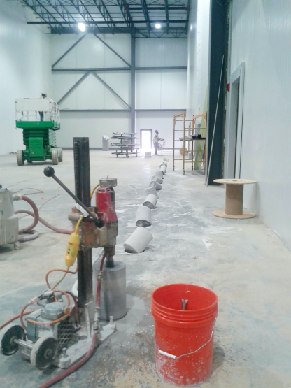 Job site with a line of drilled cores, running an M-1 Combination Core Drill Rig.